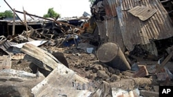 Shattered remnants are seen at the site of a bomb blast at a bar in the Nigerian city of Maiduguri, July 3, 2011