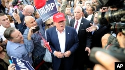 FILE - Republican presidential candidate Donald Trump, center, greets supporters in Los Angeles, Sept. 15, 2015.
