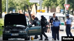 FILE - Police specialists looks into a car in Berlin, Germany, May 29, 2017.