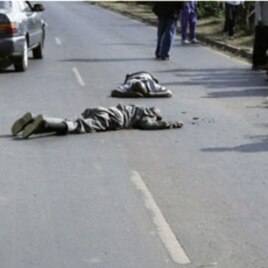 Photo published by the Daily Nation newspaper shows two Kenyan men lying dead on January 19, 2011 moments after they were shot by alleged undercover police officers on a major thoroughfare in Nairobi, 20 Jan 2011