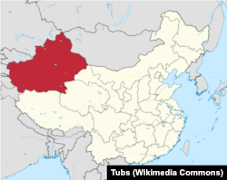 A map of China shows Xinjiang Uyghur Autonomous Region in red.