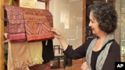 Louise Allison Cort, a ceramic curator at the Freer and Sackler galleries, is seen admiring these beautiful silk.