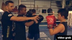 Fadi Merza, a champion Thai-style boxer who has won several titles, trains young migrants in Austria. Merza grew up in Syria.