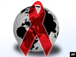 Red AIDS ribbon over globe