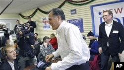 美國共和黨總統參選人羅姆尼星期一在他新罕布什爾州的競選總部