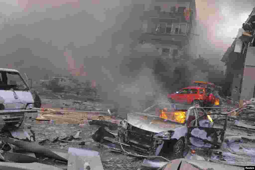 Vehicles burn after an explosion at central Damascus February 21, 2013, in this handout photograph released by Syria's national news agency SANA. The big explosion shook the central Damascus district of Mazraa on Thursday, residents said, and Syrian state