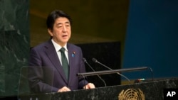Prime Minister Shinzo Abe, of Japan, addresses the 2015 Sustainable Development Summit, Sunday, Sept. 27, 2015.