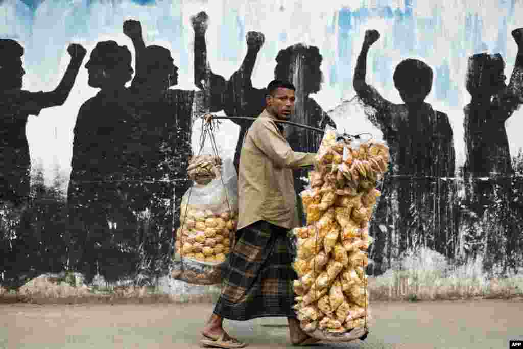 A vendor sells snacks on a street in Dhaka, Bangladesh.