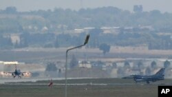 FILE - Turkish Air Force fighter planes maneuver on the runway at the Incirlik Air Base, in Adana, southern Turkey.