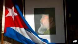 An image of Fidel Castro and a Cuban flag are displayed in honor of the late leader one day after he died, inside the foreign ministry in Havana, Cuba, Nov. 26, 2016.