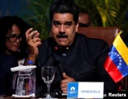FILE - Venezuela's President Nicolas Maduro speaks at the IV Gas Exporting Countries Forum in Santa Cruz, Bolivia, Nov. 24, 2017.