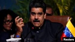 Venezuela's President Nicolas Maduro speaks at the IV Gas Exporting Countries Forum in Santa Cruz, Bolivia, Nov. 24, 2017.