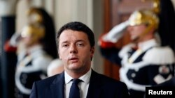Italy's Prime Minister-designate Matteo Renzi arrives to speak to reporters after a meeting with President Giorgio Napolitano at the Quirinale Palace in Rome Feb. 17, 2014.