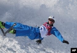 FILE - Anton Kushnir of Belarus crashes during men's freestyle skiing aerials training at the Rosa Khutor Extreme Park, at the 2014 Winter Olympics in Krasnaya Polyana, Russia, Feb. 12, 2014.