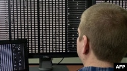 A security analyst looks at code at the U.S. government's cyber defense lab in Idaho Falls, Idaho