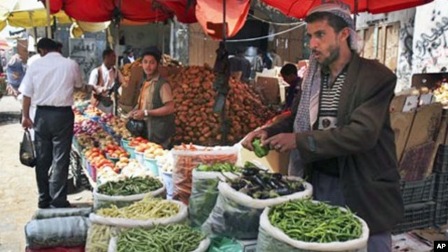A street vendor sells food on the streets of the capital San'a, Yemen. Even in Yemen's breadbasket, people are having trouble feeding themselves in what food experts say is a hidden but growing hunger problem across this impoverished country, the poorest