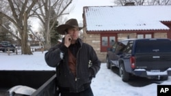Ryan Bundy talks on the phone at the Malheur National Wildlife Refuge near Burns, Ore., Sunday, Jan. 3, 2016.