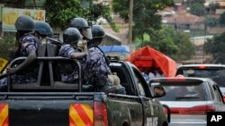 In this file photo, Ugandan riot police patrol on the streets of the Kamwokya neighborhood.