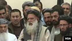 Abdul Rab Rasoul Sayyaf, an influential lawmaker and religious scholar, addresses supporters on Thursday, Oct. 3, 2013.
