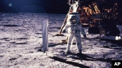 In this July 20, 1969 file photo provided by NASA, astronaut Edwin E. Aldrin Jr. walks on the surface of the moon.