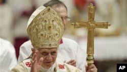 Pope Benedict XVI celebrates Christmas Mass in St. Peter's Basilica at the Vatican, Friday, Dec. 24, 2010. (AP Photo/Andrew Medichini)