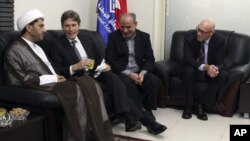 U.S. Assistant Secretary of State for Democracy, Human Rights and Labor Tom Malinowski, second from left, visits with Sheikh Ali Salman, head of al-Wefaq National Islamic Society, left, former member of the Bahraini parliament, Abdul Jalil Khalil, second from right, and Timothy J. Pounds, Deputy Chief of Mission at the US Embassy in Bahrain, right, in Manama, July 6, 2014.
