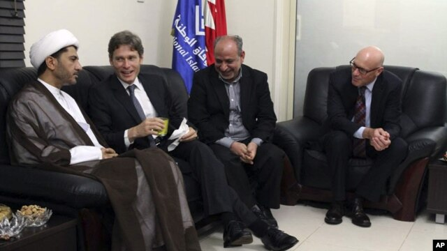 U.S. Assistant Secretary of State for Democracy, Human Rights and Labor Tom Malinowski (2nd L), visits with Sheikh Ali Salman, head of Wifaq National Islamic Society (L), former member of the Bahraini parliament, Abdul Jalil Khalil (2nd R), Timothy J. Pou