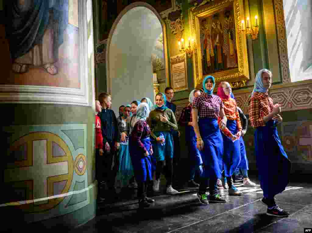 A group of school children visits a church in the Kremlin in the Russian city of Kazan.