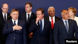 British Prime Minister David Cameron (C) stands amongst other European leaders at the EU Summit in Brussels, Belgium, June 28, 2016.