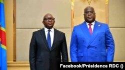 Jean-Michel Sama Lukonde le nouveau Premier ministre de la RDC (à g.) avec le président Felix Tshsiekedi au palais présidentiel, Kinshasa, RDC, 18 mars 2021.
