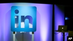 FILE - The LinkedIn logo is displayed during a product announcement in San Francisco, Sept. 22, 2016.
