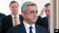 Armenian President Serge Sarkisian enters a hall to meet with Russian President Vladimir Putin in the Novo-Ogaryovo residence outside Moscow, Russia, March 12, 2013.