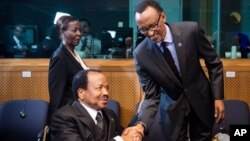 Rwanda President Paul Kagame, right, greets Cameroon President Paul Biya as he arrives for a meeting on Central African Republic, Brussels, April 2, 2014.