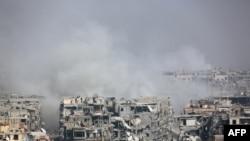 Suriya hökumət qüvvələri Şərqi Qutada üsyançıların nəzarətində olan Harasta şəhərini bombardman edir, 12 mart, 2018.