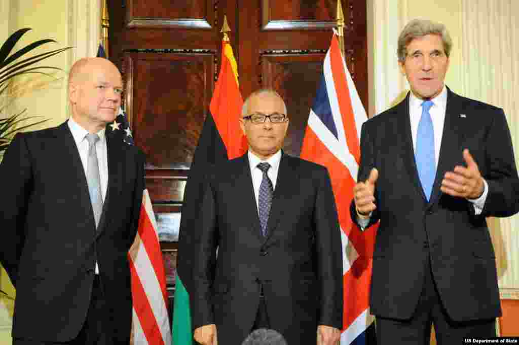 U.S. Secretary of State John Kerry speaks as he is joined by British Foreign Secretary William Hague and Libyan Prime Minister Ali Zeidan following a trilateral meeting in London, United Kingdom, on November 24, 2013.