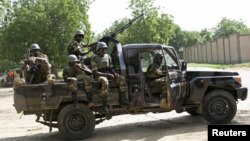 FILE - Niger soldiers provide security for an anti-Boko Haram summit in Diffa city, Niger, Sept. 3, 2015.