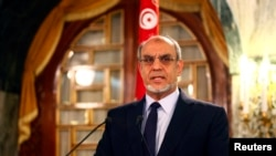 Tunisia's Prime Minister Hamadi Jebali speaks as he announces his resignation during a news conference in Tunis, February 19, 2013.