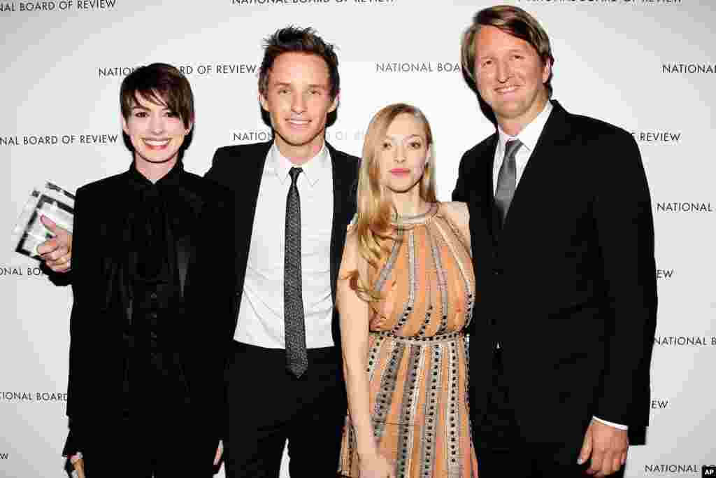 This January 8, 2013 Starpix photo shows, from left, Les Miserables' Anne Hathaway, Eddie Redmayne, and Amanda Seyfried with director Tom Hooper at the National Board of Review awards gala in New York.