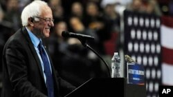 Democratic presidential candidate Bernie Sanders smiles as a bird lands on his podium when he addresses the crowd during a rally at the Moda Center in Portland, Ore., Friday, March 25, 2016. (AP Photo/Steve Dykes)
