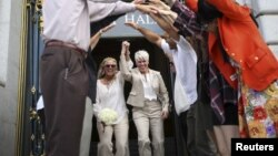 Stacy Wood, left, and her wife, Michele Barr, leave San Francisco City Hall after getting married, June 26, 2015.