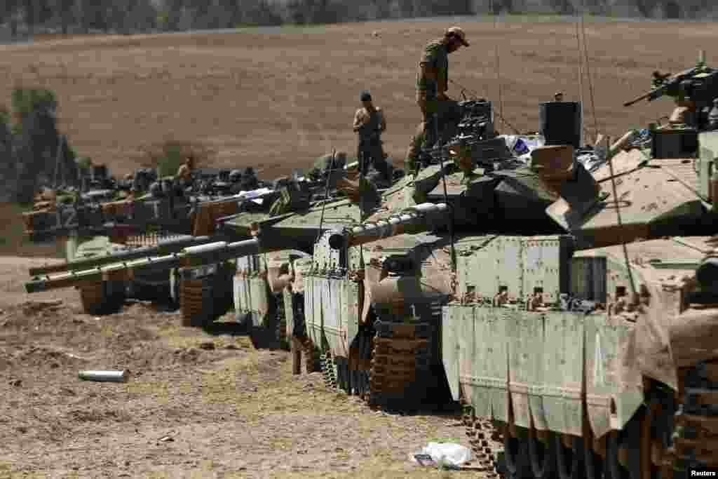 Israeli tanks at a staging area near the border with the Gaza Strip July 31, 2014.