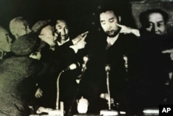 FILE - Tibet's 10th Panchen Lama is seen undergoing a Cultural Revolution struggle session in Tibet's capital Lhasa, in this 1964 photo.