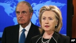 Secretary of State Hillary Rodham Clinton (R) speaks while flanked by Special Envoy for Middle East Peace Talks, Senator George Mitchell, 20 August 2010