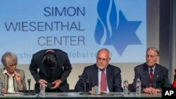 Hikaru Kimura, Mitsubishi Materials' Senior Executive Officer, bows to offer an apology at the Simon Wiesenthal Center in Los Angeles, California, July 19, 2015.