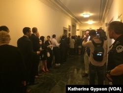 The hallway outside the hearing room where former U.S. Secretary of State Hillary Clinton will testify Thursday before the Republican-led special House committee investigating the deadly 2012 attack on the U.S. consulate in Benghazi, Libya, in Washington.