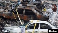 15일 레바논 수도 베이루트 외곽에서 발생한 차량폭탄 공격 현장.