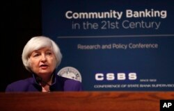 FILE - Federal Reserve Chair Janet Yellen delivers opening remarks during a community banking conference, Oct. 4, 2017, at the Federal Reserve Bank of St. Louis.