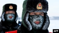 Chinese paramilitary police border guards train in the snow at Mohe County in China's northeast Heilongjiang province, on the border with Russia, Dec. 12, 2016.