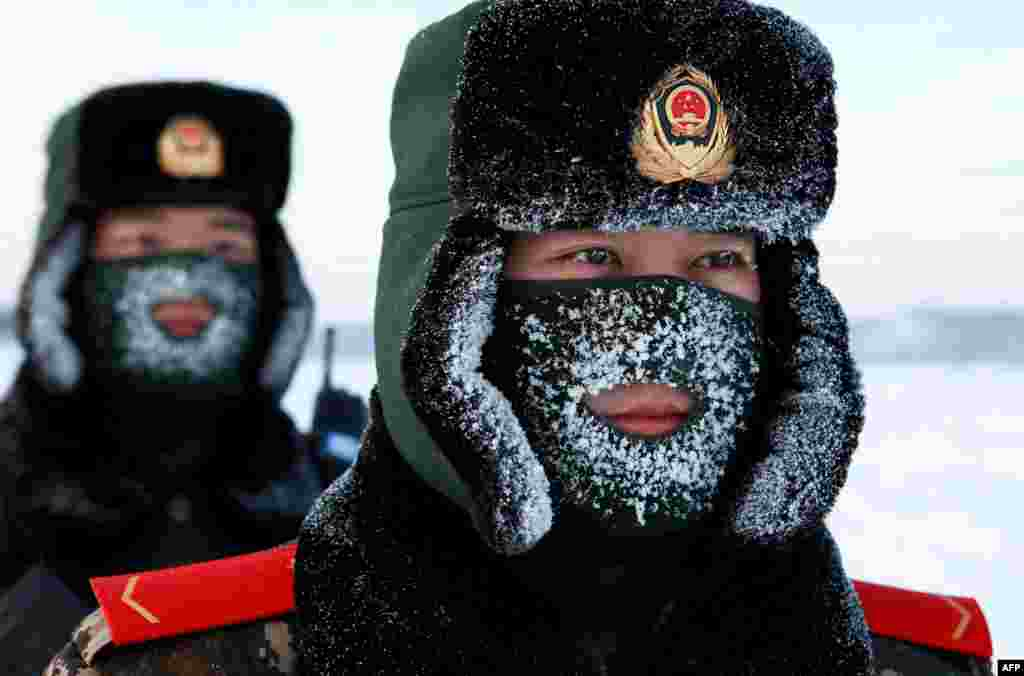 Chinese paramilitary police border guards train in the snow at Mohe County in the northeast Heilongjiang province, on the border with Russia.