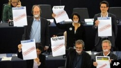 Some EU legislators covered their mouth with duct tape and held banners protesting Hungary's controversial media law, as that country's PM Viktor Orban spoke at the European Parliament in Strasbourg, Jan. 19 2011